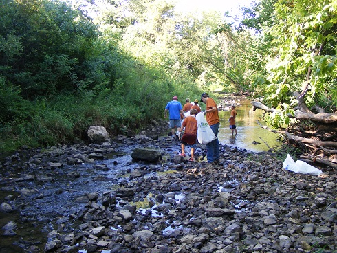 Volunteers cleaning up creek